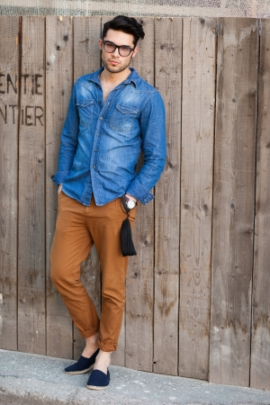 handsome young man posing outdoors
