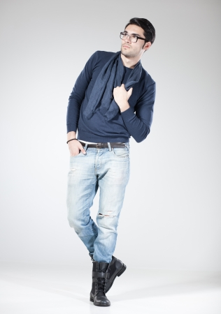 attractive man posing in the studio - full body