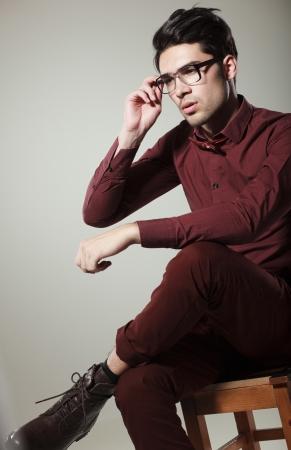 handsome male model dressed elegant posing in the studio looking serious photo