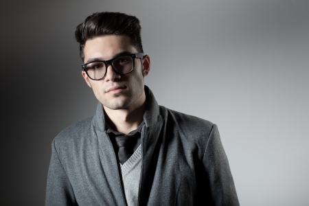 attractive man dressed casual wearing glasses - studio shot, copy space photo