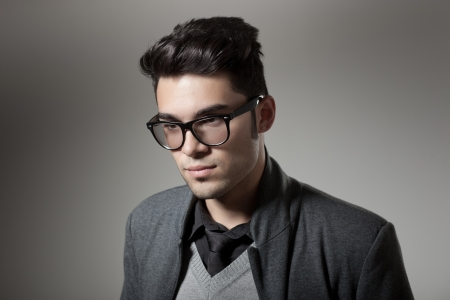 attractive man dressed casual wearing glasses - studio shot, copy space Zdjęcie Seryjne - 16865798