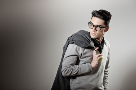male model: attractive man dressed casual wearing glasses - studio shot, copy space Stock Photo
