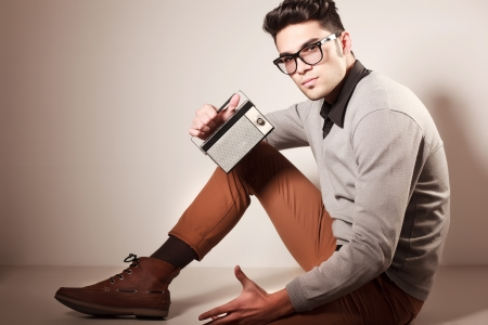 grey  hair: attractive man dressed casual wearing glasses - studio shot, copy space Stock Photo