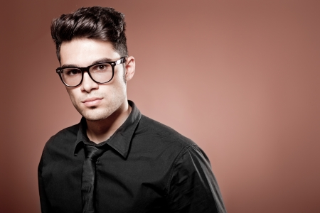 human hair: attractive man dressed casual wearing glasses - studio shot, copy space Stock Photo