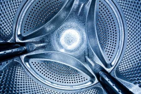 interior of a washing machine whith water drips photo