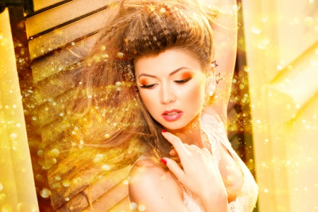 very beautiful model wearing gold make-up photo