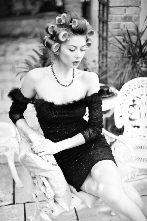 sexy woman posing as an aristocrat - fashion shoot  intentional soft focus and vintage look  photo