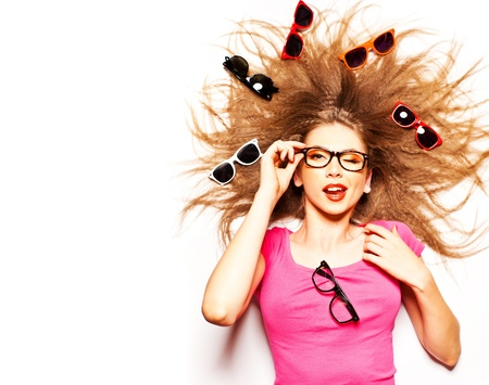 funny cute girl with curly hair and hipster glasses - conceptual