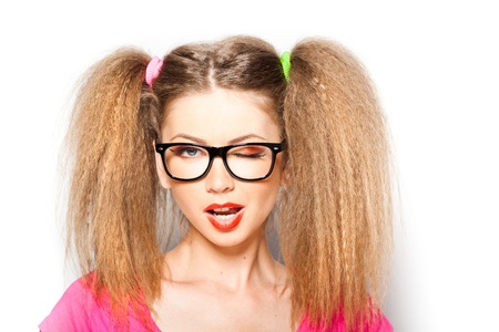 curly girl with hipster glasses and two tails isolated on white