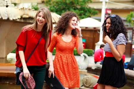 socializing: three beautiful women laughing and having fun