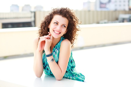 beautiful women with curly hair smiling outdoor on a sunny day Stock Photo - 18148654