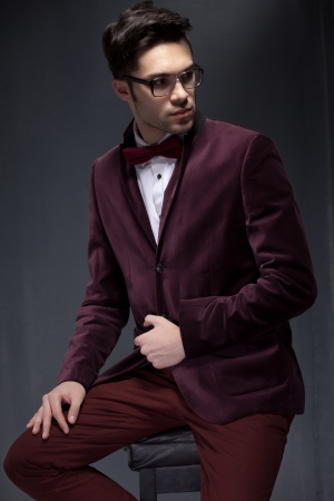 sexy fashion male model dressed elegant - casual posing against wall Stock Photo - 18527436