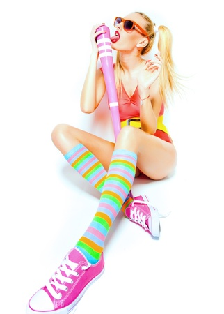 sexy baseball girl wearing colorfull clothes posing with a baseball bat Stock Photo