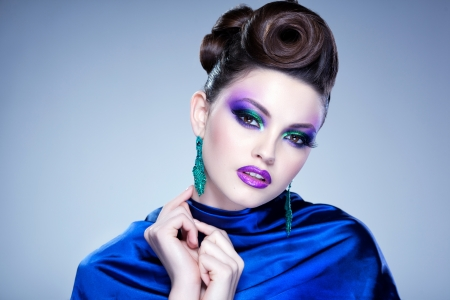 professional blue make-up and hairstyle on beautiful woman face - studio beauty shot Stock Photo - 19381321