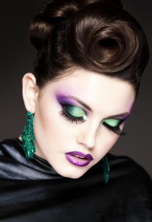 professional blue make-up and hairstyle on beautiful woman face - studio beauty shot Zdjęcie Seryjne