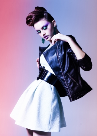 elegance fashion girls look sensuality young: beautiful woman dressed elegant punk posing in the studio Stock Photo