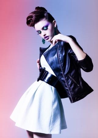 beautiful woman dressed elegant punk posing in the studio Standard-Bild