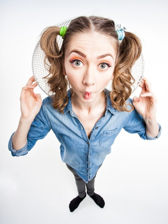 cute funny girl with two pony tails smiling - wide angle shot Stock Photo - 21242153