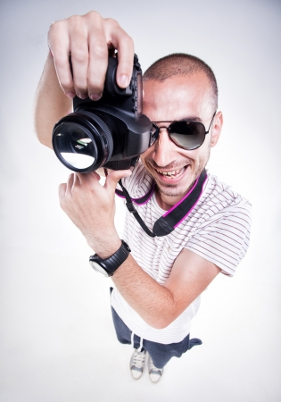 funny photographer posing with a camera smiling photo