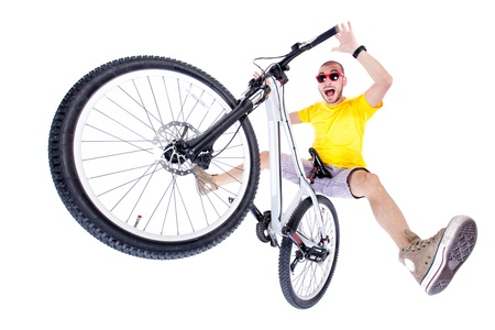 air jump: crazy boy on a dirt jump bike isolated on white - wide studio shot Stock Photo