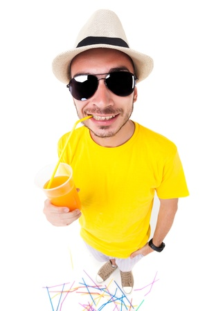 funny man drinking juice wearing sun glasses, hat and yellow t shirt on white  photo