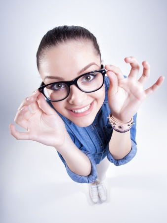 pretty girl with perfect teeth wearing geek glasses smiling  photo