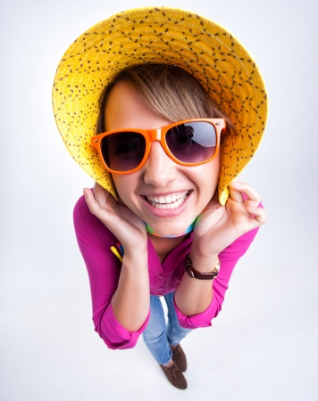 pretty girl with funny hat smiling in the studio Stock Photo