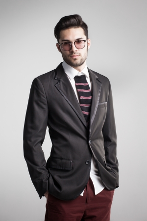 modeling: sexy man dressed elegant with s sock tie looking serious - funny concept Stock Photo