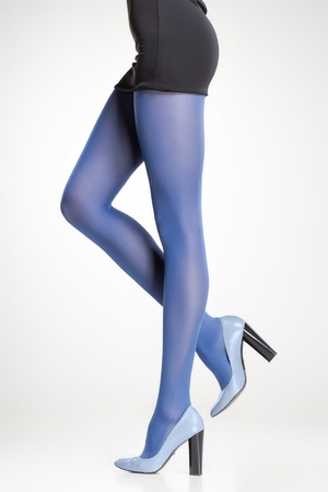blue stockings on sexy woman legs isolated on grey Stock Photo
