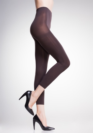 brown tights on sexy woman legs isolated on grey Stock Photo