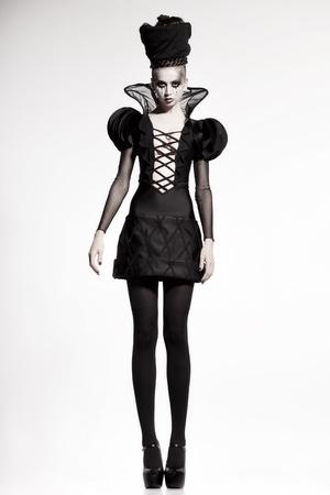 fashion shoot: beautiful model posing as chess queen - fashion shoot