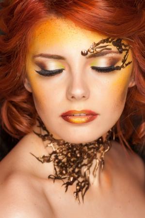 beauty shot of beautiful woman wearing professional make-up on  photo
