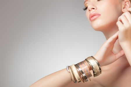 beautiful woman wearing jewelry, very clean image with copy space photo