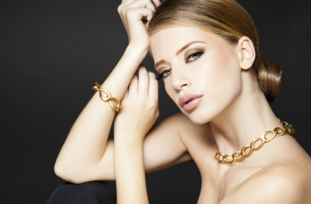 gold jewelry on beautiful woman model posing glamorous  photo
