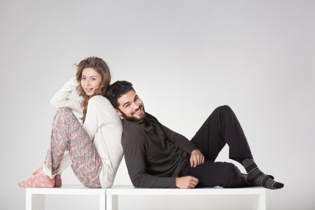 Happy couple in pyjama posing in the studio photo