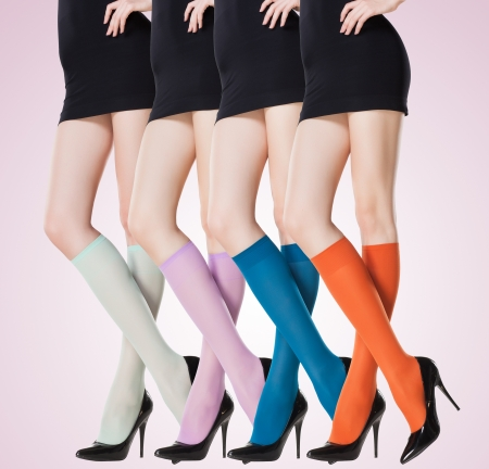 collection of colorful short stockings on sexy woman legs Standard-Bild