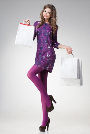 long sexy legs: beautiful woman with long sexy legs holding shopping bags