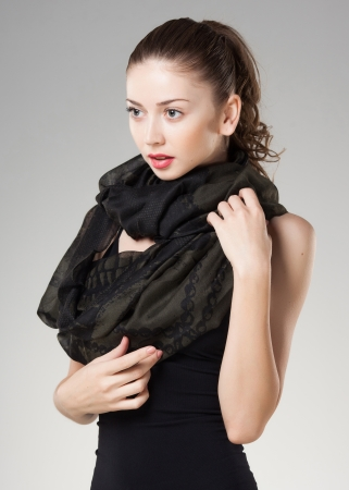 scarves: beautiful woman wearing kashmir scarf isolated on grey