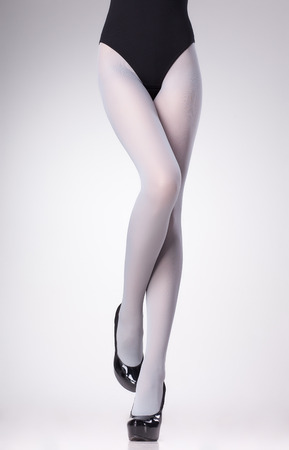 nylons: stockings on sexy woman legs isolated on grey  Stock Photo