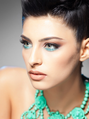 professional make-up and hairstyle on beautiful woman  photo