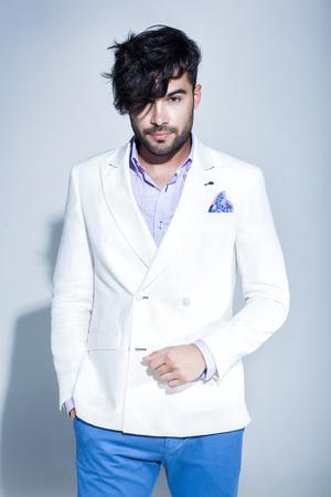 sexy fashion: sexy fashion male model dressed elegant - casual posing against wall