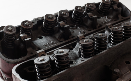 v8: Opened old v8 engine heads showing valves and springs Stock Photo