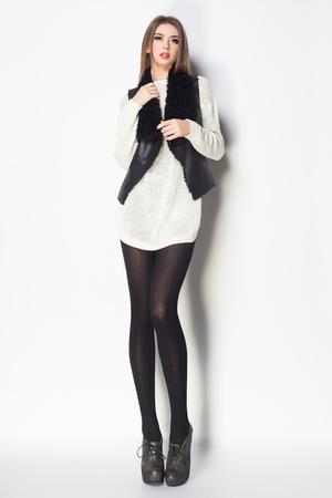 beautiful woman with long sexy legs dressed elegant posing in the studio - full body Zdjęcie Seryjne
