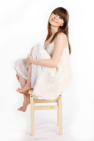 belonging to the caucasoid race: Portrait of a young woman sitting on chair against isolated white background
