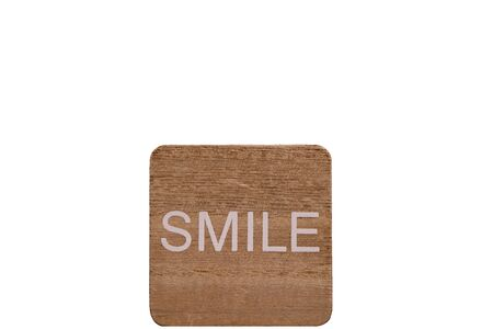 Smile on wood plate. (Isolated)