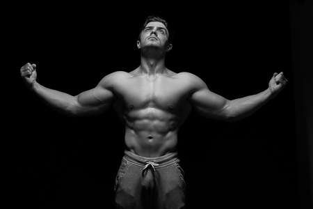Sexy muscular fitness man. Black and white image.