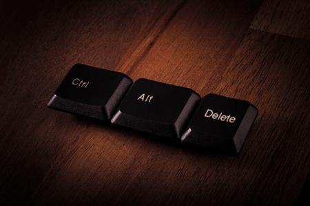Black Ctrl, Alt, Del keyboard keys wood Stock Photo