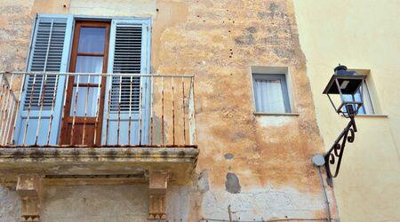 characteristic balconies in the historic center of Favignana Italy