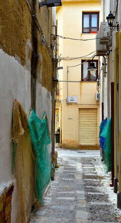 fishing nets in the alleys of the historic center of Mazara del Vallo Sicily Italy Archivio Fotografico