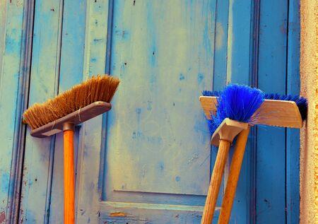 brooms leaning against the door in the Arab quarter in mazara del vallo sicily